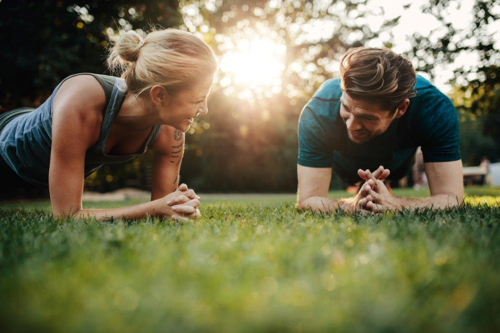Canva Fit Young Man And Woman Exercising In Park